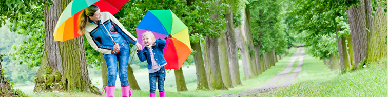 lady and child under a rainbow umbrella